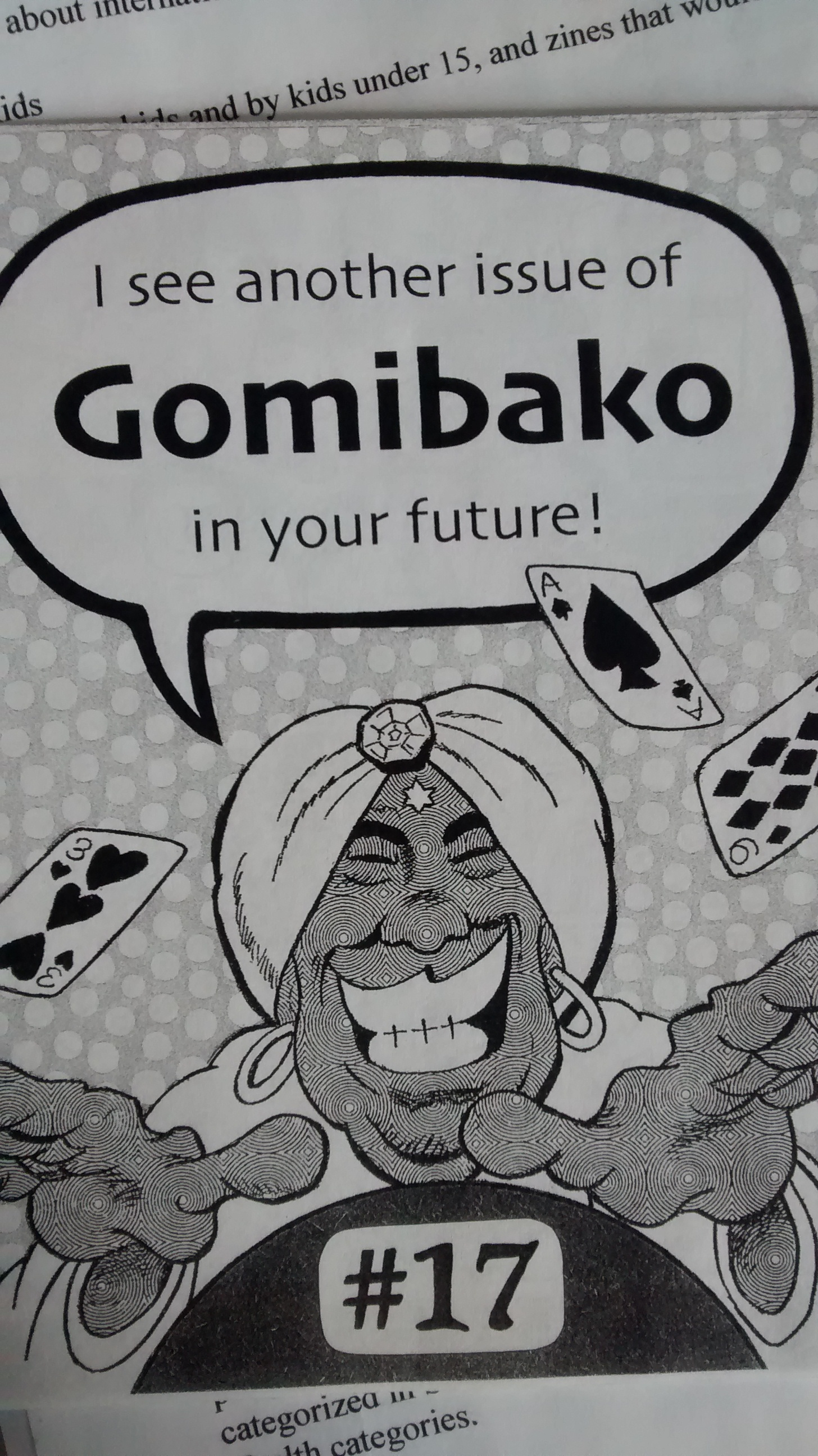 "Cartoon of a turban-wearing Genie mid-card trick, with flying cards (3 of Hearts, Ace of Spades, 9 of Diamonds) with a speech bubble reading, ""I see another issue of Gomibako in your future!"". Centred at bottom is the issue number, 17"