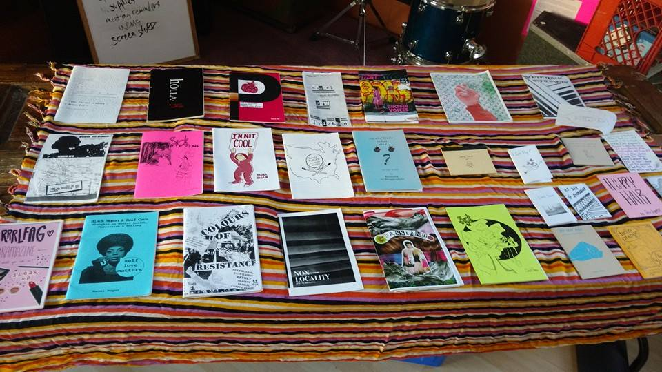 Image of a table displaying a selection of zines.