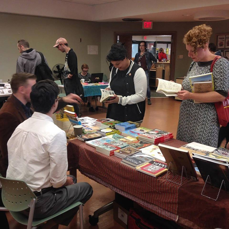 People browsing zines at the 2017 Zine Fair.